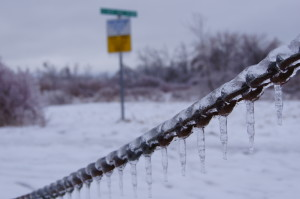 Frozen chain with warning Sign in the snowy background.